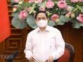 越南政府总理范明政呼吁全民携手抗击疫情