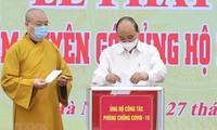 Presidente de Vietnam llama a los esfuerzos de todo el pueblo para hacer frente al covid-19