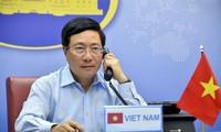 越南政府副总理兼外长范平明与英国外交大臣拉布进行电话会谈