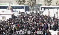 SYRIE : La première évacuation des civils et combattants de Harasta