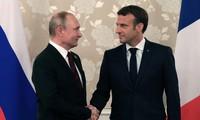 France, Russia voice cautious optimism on Ukraine