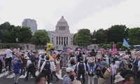 Thousands march outside Japan parliament to protest US military base