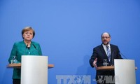 Angela Merkel's CDU approves coalition deal with SPD