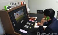 Two Koreas reopen hotlines