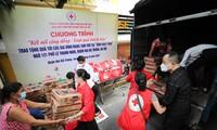 470.000 Tüten der Hilfsgüter an die von Covid-19 betroffenen Menschen überreichen