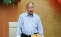 PM Nguyen Xuan Phuc memimpin sidang tentang opsi mengekspor beras