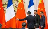 A Pékin, Emmanuel Macron et Xi Jinping unis dans la critique de Donald Trump