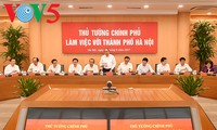 Top Government leaders work with Hanoi authorities