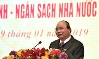 PM Nguyen Xuan Phuc menghadiri konferensi evaluasi instansi keuangan
