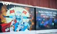 Keunikan Sudut Jalan Berhiaskan Mural Propaganda Pencegahan dan Penanggulangan Wabah Covid-19 di Kota Hanoi