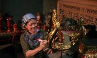 Die Schönheit bei der Arbeit der vietnamesischen Frauen