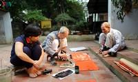 Wiederbelebung der folkloristischen Bilder Kim Hoang