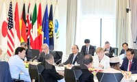 Prime Minister Nguyen Xuan Phuc delivers his speech in during the expanded G7 Summit