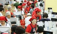Japan postpones sales tax until 2019