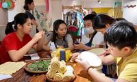Children learn about Vietnamese silk weaving