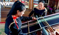 Ede women preserve traditional brocade-weaving craft