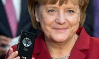 Merkel demande à Poutine le retrait total des troupes russes d'Ukraine