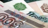 Le rouble russe et le dollar canadien s'effondrent