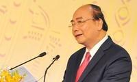 PM Nguyen Xuan Phuc menghadiri konferensi pertemuan dengan para investor di Provinsi Nghe An