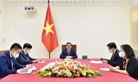 チン首相、WHO事務局長と電話会談