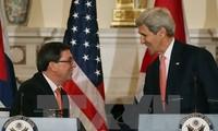 Media massa internasional menyambut Kuba dan Amerika Serikat memulihkan hubungan diplomatik.