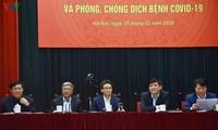 Deputi PM Vu Duc Dam menghadiri konferensi tentang pencegahan dan penanggulangan wabah Covid 19
