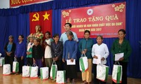 Poor people and AO victims helped to enjoy Tet