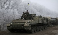 Both sides in Ukraine observe cease-fire, although shelling continues