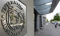 IMF says Greece made overdue payments is no longer in default