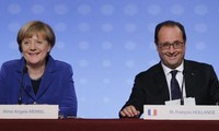French, German leaders insist migrant crisis a challenge to EU