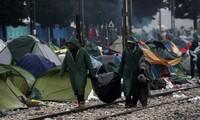 German, Greek leaders blast Balkan nations for closing migrant route