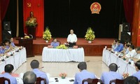 President Tran Dai Quang works with the Supreme People's Procuracy