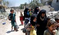 Irak: Des milliers de personnes sont retenues à Mossoul