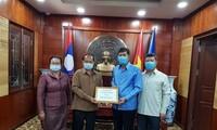 Covid-19: le Laos remet au Vietnam une enveloppe de 12.760 dollars