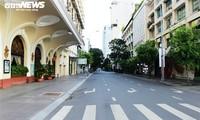 Đường phố vắng lặng trong ngày đầu TP.HCM giãn cách theo Chỉ thị 16