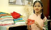 ベトナムの絹製マスクを世界に紹介する女の子