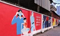ハノイ市内で新型コロナ対応を宣伝する壁画が披露される