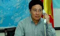 越南政府副总理兼外长范平明同中国外长王毅通电话