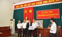 越南天主教同胞向长沙军民捐助30亿越盾