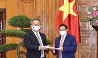 越南政府总理范明政会见日本驻越南大使山田贵雄