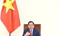 范明政建议世卫组织协助越南成为疫苗生产中心