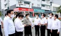越南政府总理范明政视察胡志明市新冠肺炎疫情防控工作