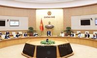 越南政府总理范明政主持政府与越南劳动总联合会工作会议