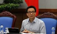 Deputi PM VN, Vu Duc Dam memimpin sidang tentang pengajaran kejuruan kepada tenaga kerja pedesaan