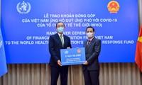 Übergabe der symbolischen Spende Vietnams für Fonds zur Reaktion auf Covid-19 der WHO