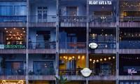 Foto über einen Wohnblock mit zahlreichen Cafés in Saigon in National Geographic UK