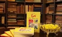 Das frühe Tet-Fest durch Ansichten französischer und vietnamesischer Gelehrter