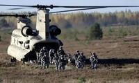 NATO memperkuat pasukan reaksi cepat dan menggelarkan lagi pangkalan militer