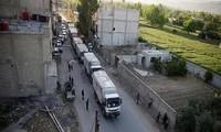 Iringan kendaraan bantuan tiba di kota Homs, Suriah