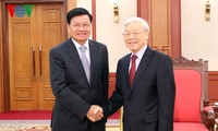 Sekjen KS PKV Vietnam, Nguyen Phu Trong menerima PM Laos, Thongloun Sisoulith